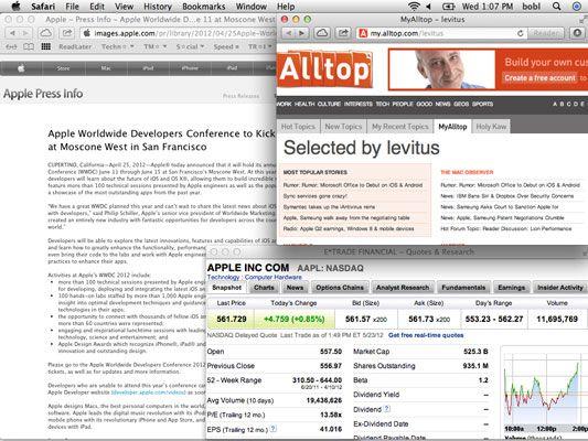 Web-surfing espaço, com três janelas do Safari (Informação de imprensa Apple, página Alltop, e eTrade) dispostos j